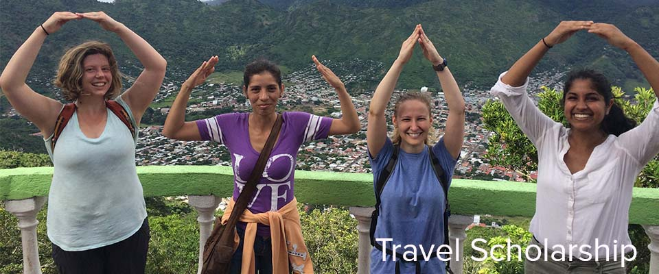 four female students spelling O-H-I-O with their arms