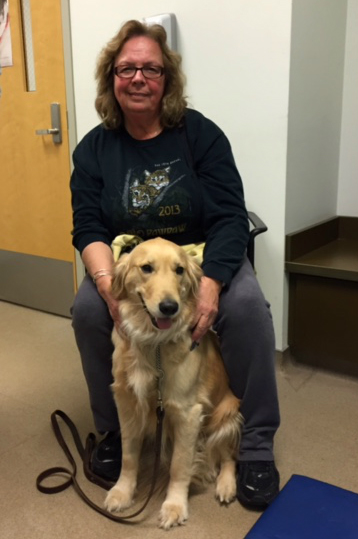 Jennifer Trotta sits with 3-1/2-year-old Golden retriever and comfort dog (similar to a therapy dog), Halle.