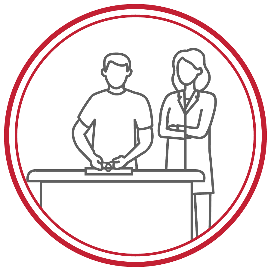 line drawing icon with female instructor watching male student use knot tying board at a desk